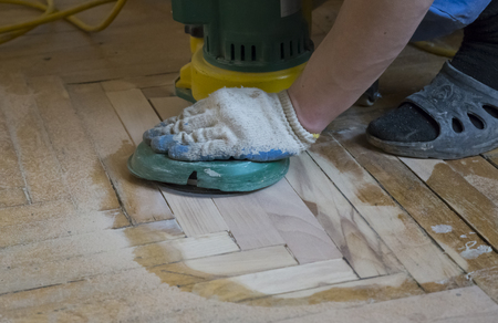 Renovation of an old wooden parquet floor with a grinding machine Reklamní fotografie