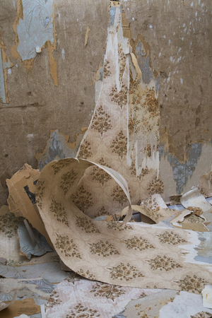 Old wallpaper removed off a concrete wall. Renovation of a house Reklamní fotografie