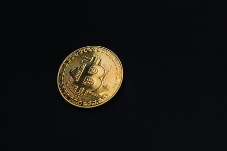 Golden bitcoin on black background with copy space. Cryptocurrency mining concept Reklamní fotografie