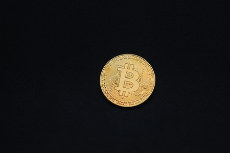 Golden bitcoin on black background with copy space. Cryptocurrency mining concept Imagens - 122942040