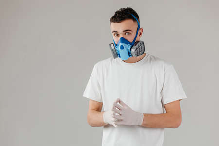Man wearing full-Face Respirator protective gas mask against virus, radiation, bacteria and dust. Professional mask