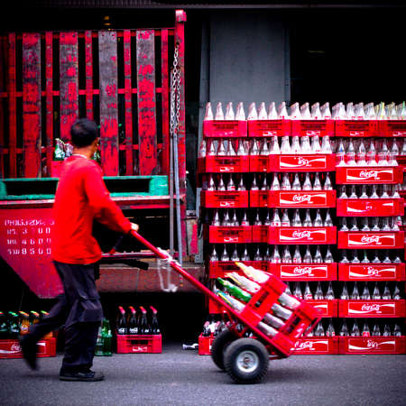 coke bottle: man moving coca cola coke chest and bottle