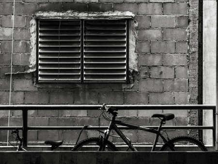bike parking: bike parking next to window in black and white