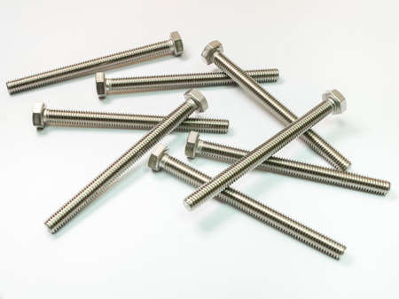 metal fastener: screw and nuts on white background Stock Photo