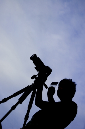 silhouette of a photographer Stock Photo