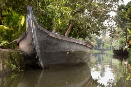 Boats moored in the calm waters of a canal in Alappuzha Stock Photo - 16455070
