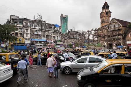 Taxis, cars, bikes and pedestrians try driving on the streets of Mumbai