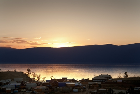 Sunset on Olkhon. The town is being left without light and see the landscape sliuetas and village Stock Photo - 16454853