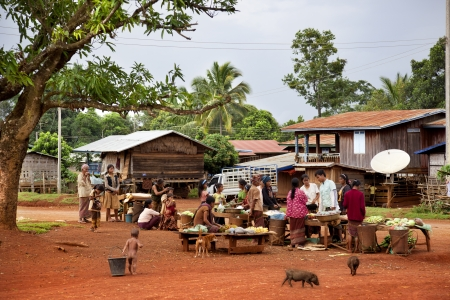 Laotian villages, markets are mounted near roads