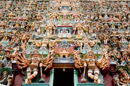 hindu gods: colorful reliefs of Hindu gods in the temple of Meenakshi