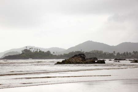 The monsoon change much the landscape of Patnem beach in Goa. India. A sky full of clouds, a gray day and its reflection in the wet sand Stock Photo - 16454838