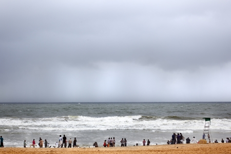 Calangute, India-August 31, 2012.While Indian tourists enjoy the beach, on the horizon is the torrential rains of the monsoon will soon come to the coast Stock Photo - 16376346