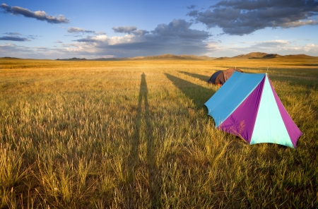 Camping in the Gobi desert at sunset creating shadows lengthened. photo