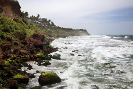 waves toward the cliffs of varkala Stock Photo - 16455066