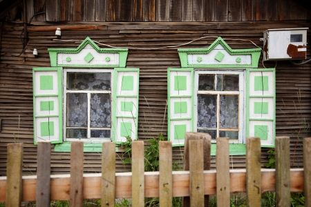 Typical wooden windows of a house on Lake Baikal in Russia