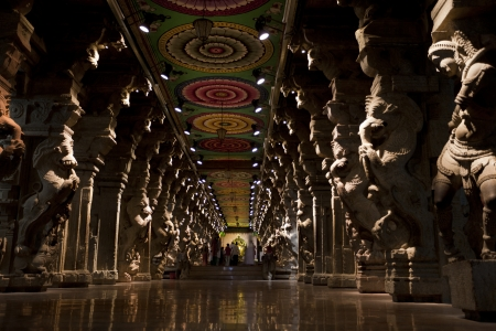 Madurai, India-September 11, 2012. Many parishioners and pilgrims visit every year the Sri Meenakshi Hindu Temple where they pray and contemplate the architectural beauty