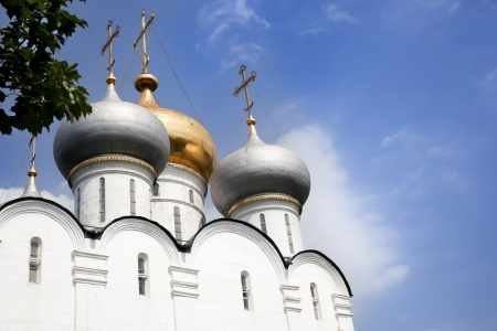 domes of the monastery cut into the sky Stock Photo