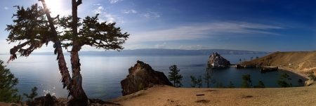 panoramic cliffs of Olkhon, a shaman tree and beach full of tourists photo