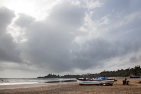 Fishing boats on the sand at the beach Patern in Goa Stock Photo