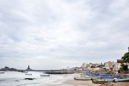 Kanyakumari, India-September 9, 2012. Dozens of fishing boats moored in the sand and the sea while the townspeople performs his duties as a normal day Stock Photo - 16781985