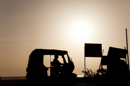 allepey: Backlight of a rickshaw on the beaches of allepy Stock Photo