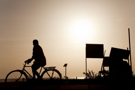 silhouette of a cyclist on the sunset beaches allepy Stock Photo