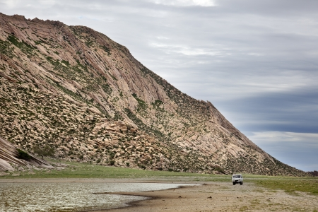 independent mongolia: a van in the gobi desert Stock Photo