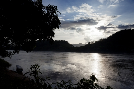 immobility: Sunset on the Mekong River