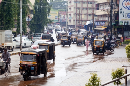 Mangalore, India -  The traffic on the streets of Mangalore is a big mess  Taxis, mopeds and pedestrians cross without any order for a principal avenue of Mangalore  Editoriali