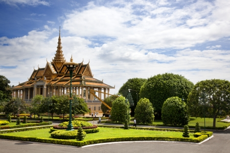 Phnom penh, Cambodia-   Workers repair and care of the palace gardens on a sunny August morning Editorial