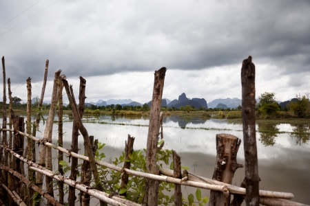 virgil: monsoon rains over a paddy in laos