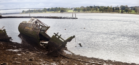A wreckage of an abandoned ship anchored in Bowling  Scotland photo