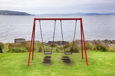 swing on seaside play equipment in Arran Island  Scotland  photo