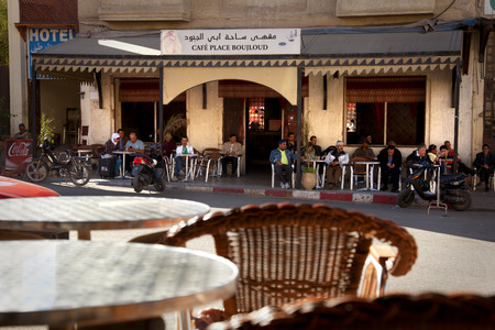 Fez, Morocco-April 25, 2014  Group of people sitting around a table and sharing some drinks during a nice spring afternoon on the terrace of a bar in Fez