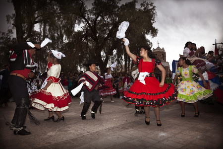 San Pedro de Atacama, Chile-September 17, 2014: Chilean typical dance performed by a group of people in a National day of Chile Editoriali