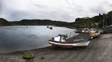 specialists: Fishing boats moored in Angelmo, tourist area and restaurant Specialists in cooking fish