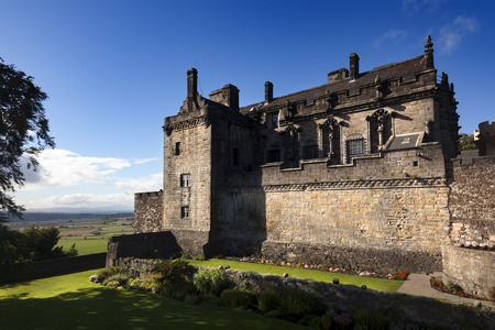 king james: Stirling, Scotland - September 17, 2013: Stirling Castle, viewed from the palace gardens. The palace building was started by King James V in the early 1500s, but it was not completed until after his death.