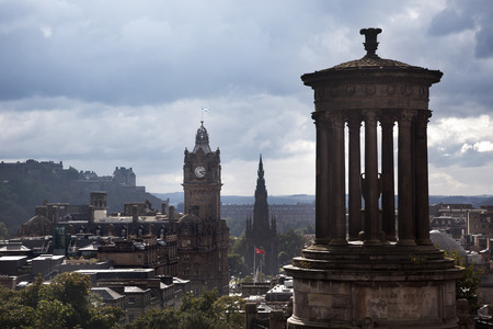 scott monument: Edinburgh, Scotland-September 7, 2013: After the rain, when the clouds break, the city lights up with the sunshine, showing a view from Calton Hill towards Edinburgh Castle and the Scott Monument Editorial