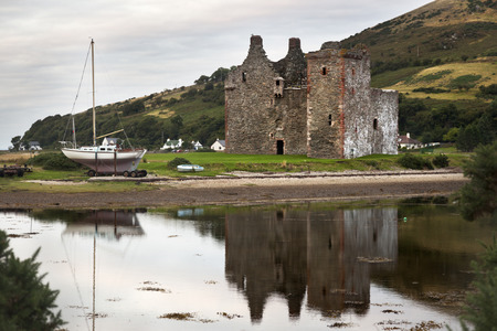 supposed: View of Lochranza bay and the castle. This is supposed to be the castle that served as a reference for one of Hergés TinTin stories. Stock Photo