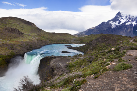 puerto natales: Waterfall in fornt of Los Cuernos, Las Torres National Park, Chile Stock Photo