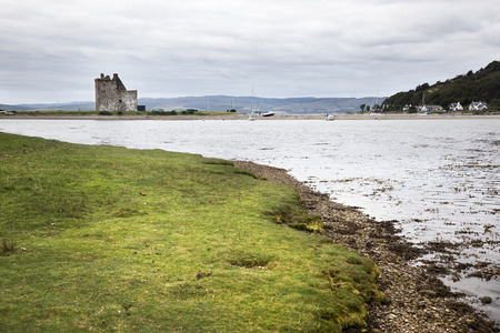 supposed: Arran, Scotland-August 28. 2013: View of Lochranza bay and the castle. This is supposed to be the castle that served as a reference for one of Hergés TinTin stories. Editorial