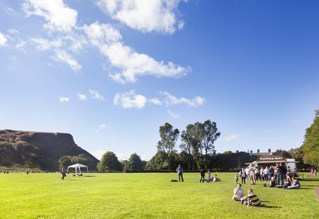 citypark: Edinburgh, UK - September 22, 2013: People in Edinburgh, enjoying a warm, sunny day in the park