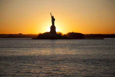 Sunset behind The statue of Liberty Stock Photo