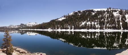 Raflections in a lake in California. Way to Tahoe lake