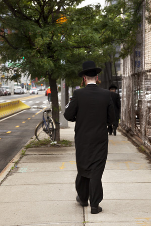 Brooklyn, USA-June 6, 2017: Orthodox Jew walking the streets of New York