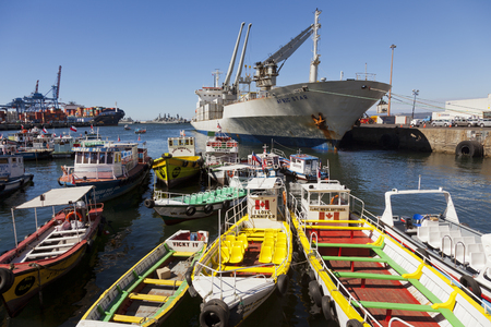 Valparaiso, Chile-February 2, 2014: Tourist boats moored in the port of Valparaiso