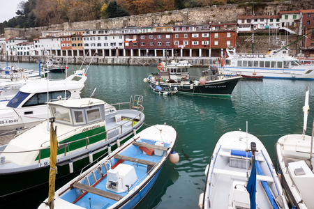 San Sebastian, Spain-December 19, 2014: All boats waiting for a good weather to set sail in harbor boats in Donosti. Spain