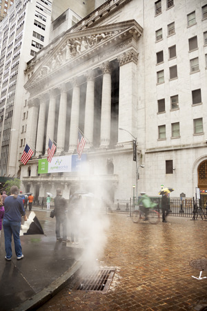 Manhattan, USA-June 6, 2017: Smoke from the condensation of the pipes in front of the New York Stock Exchange Editorial