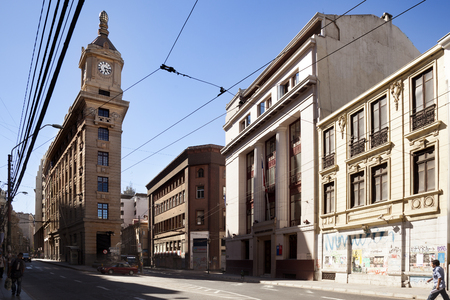 Valparaiso, Chile-February 2, 2014:Old Valparaiso and watch Turri building in the middle of the street, downtown of valparaiso in a sunny day, and some tourist walking around Editorial