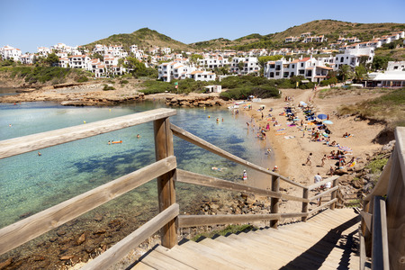 Menorca, Spain-August 27, 2015: Views of a beach full of people on August in Fornells beach
